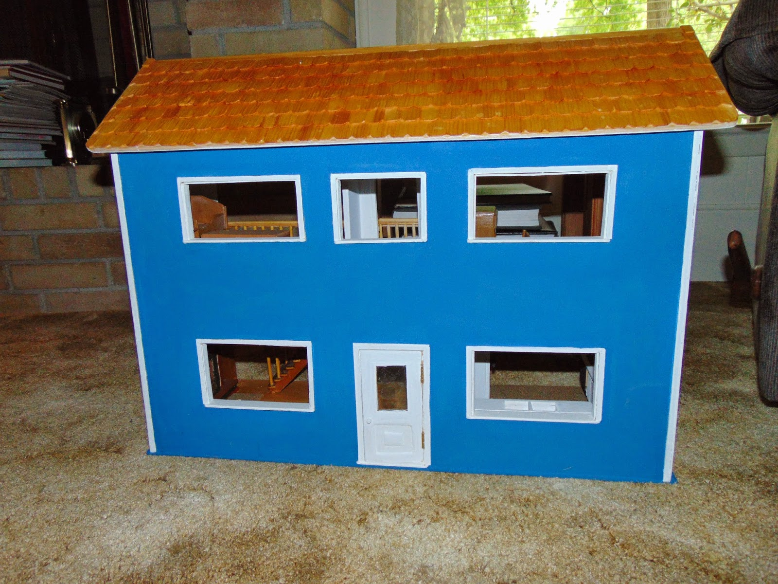 Blue painted doll house with removable roof