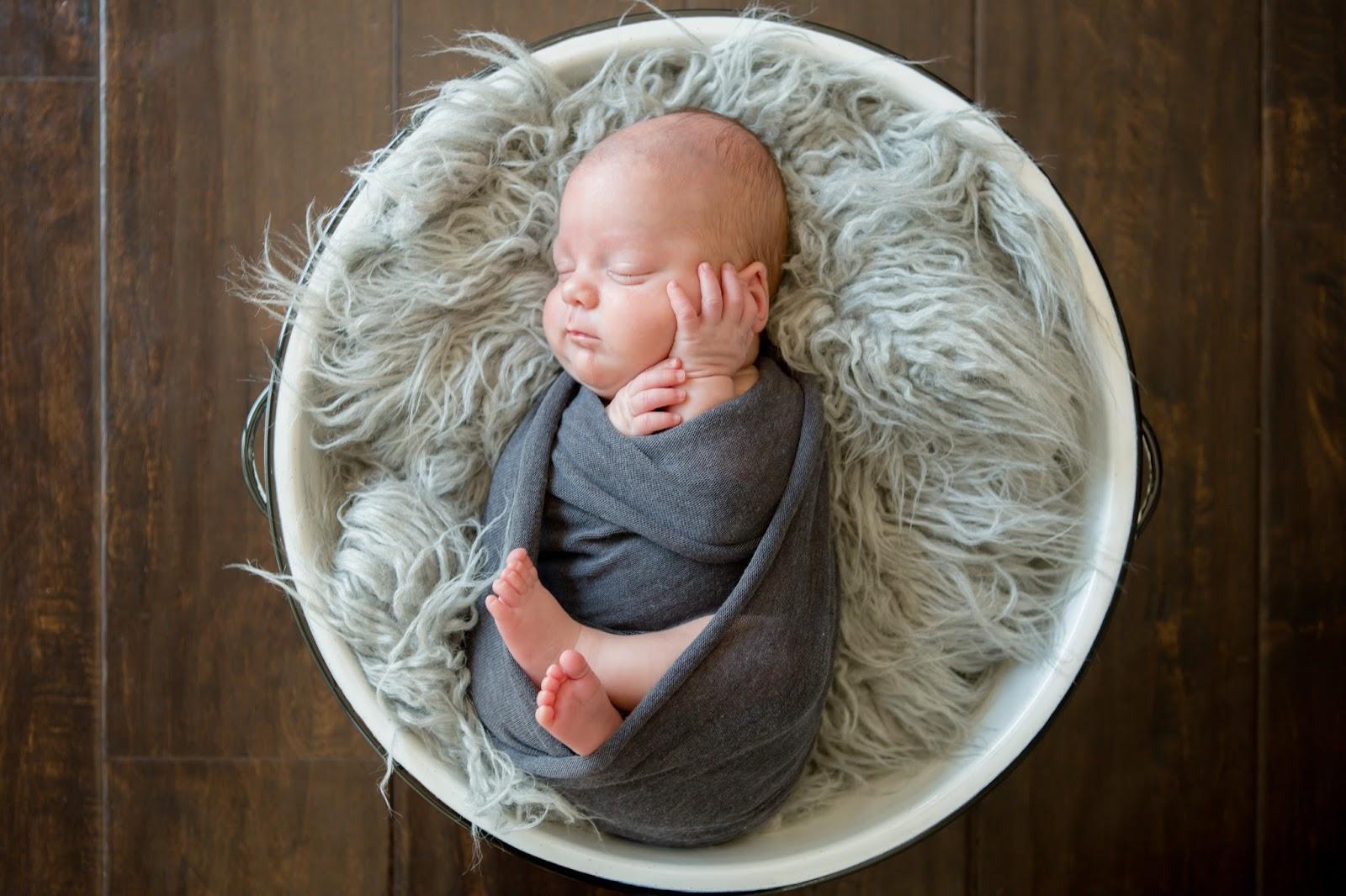 newborn boy swaddled