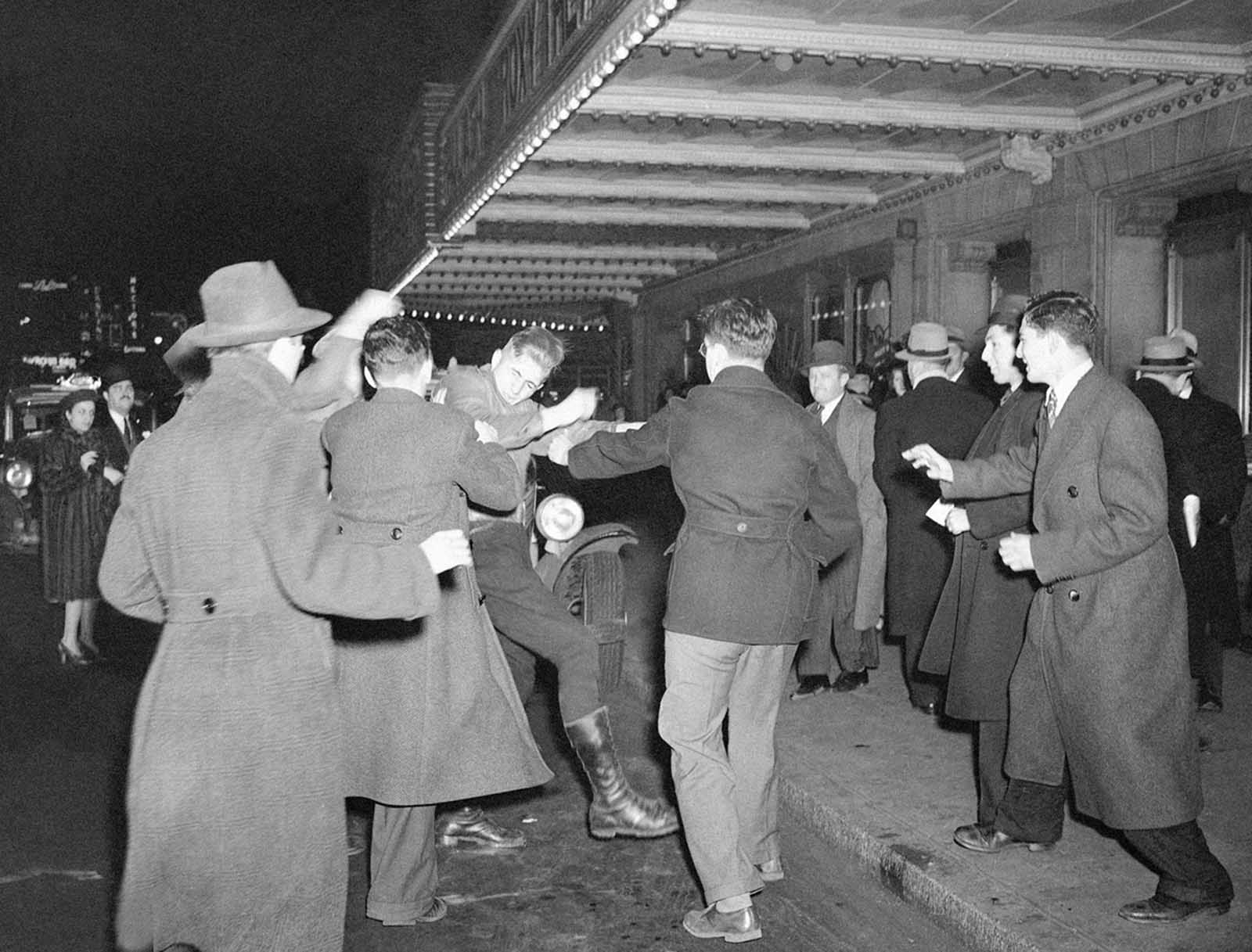 A crowd of demonstrators outside New York's Madison Square Garden seize a uniformed member of the German American Bund who had emerged from a Bund rally in the Garden and attempted to enter a taxi, on February 20, 1939.