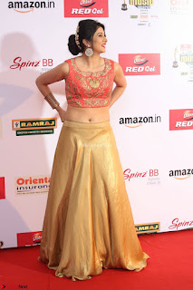 Harshika Ponnacha in orange blouuse brown skirt at Mirchi Music Awards South 2017 ~  Exclusive Celebrities Galleries 109.JPG