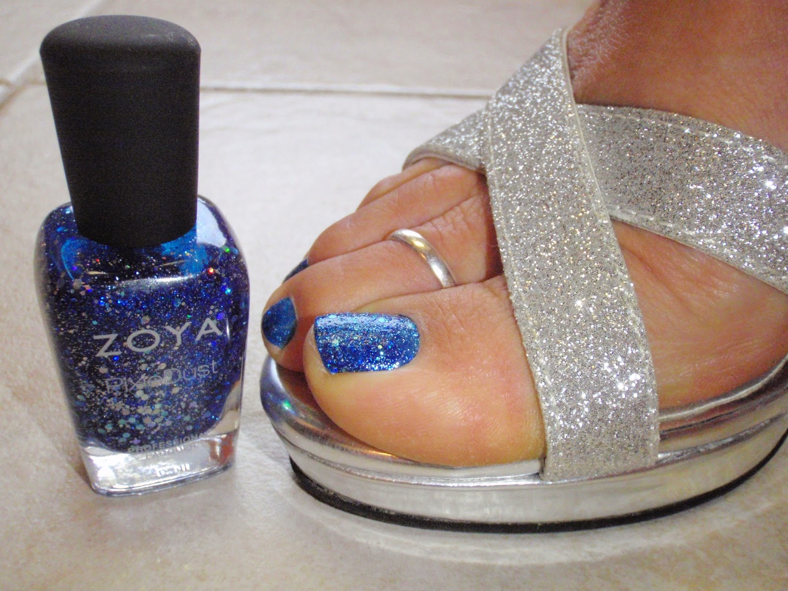 Zoya Nori  with silver shoe