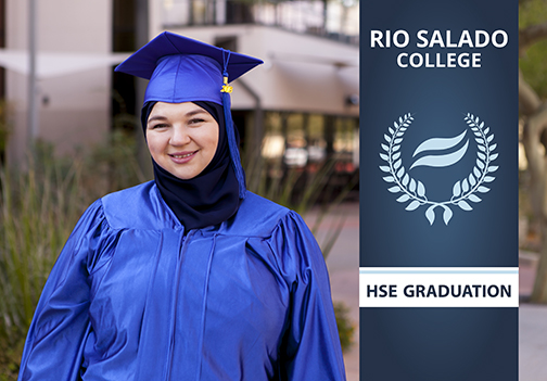 Photo of Maida Dugalic in graduation regalia.  HSE Graduation Banner.