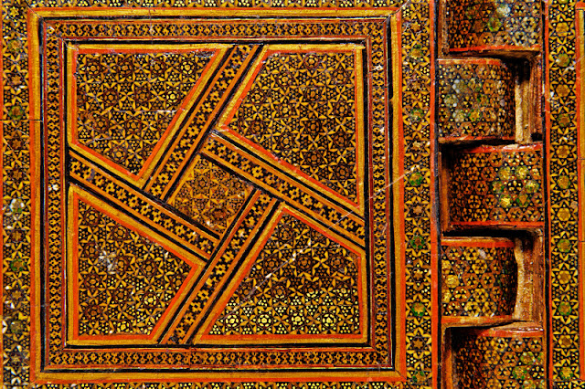 Detail of the decorative inlay pattern of gold stars on an Iranian Qur'an book stand