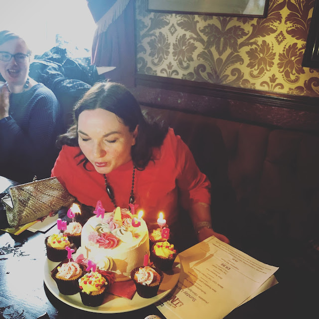Blowing out the candles on my birthday cake, living my best life, mandy charlton, photographer, writer, blogger