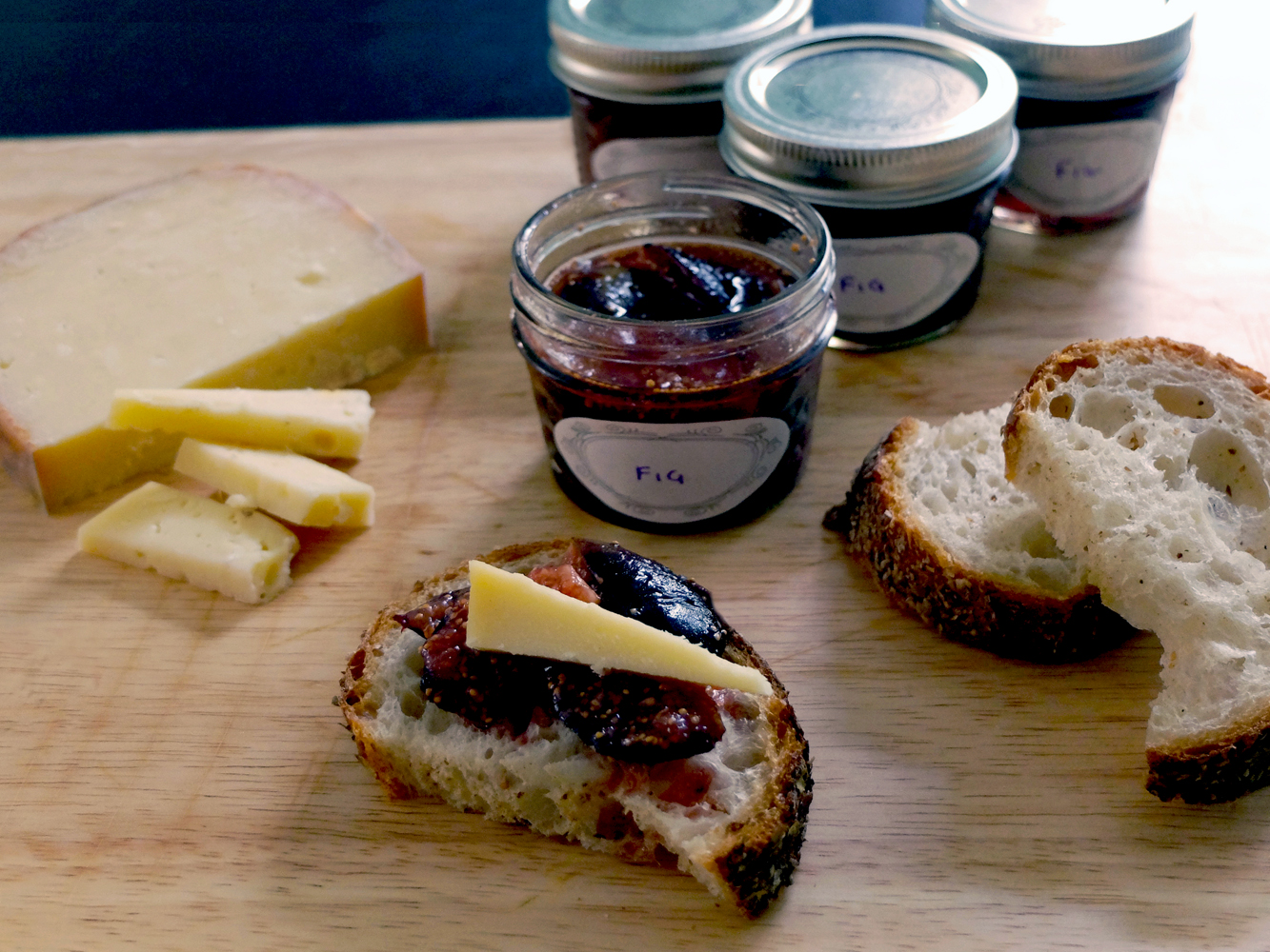Fresh Mission fig preserves with aged gouda cheese.