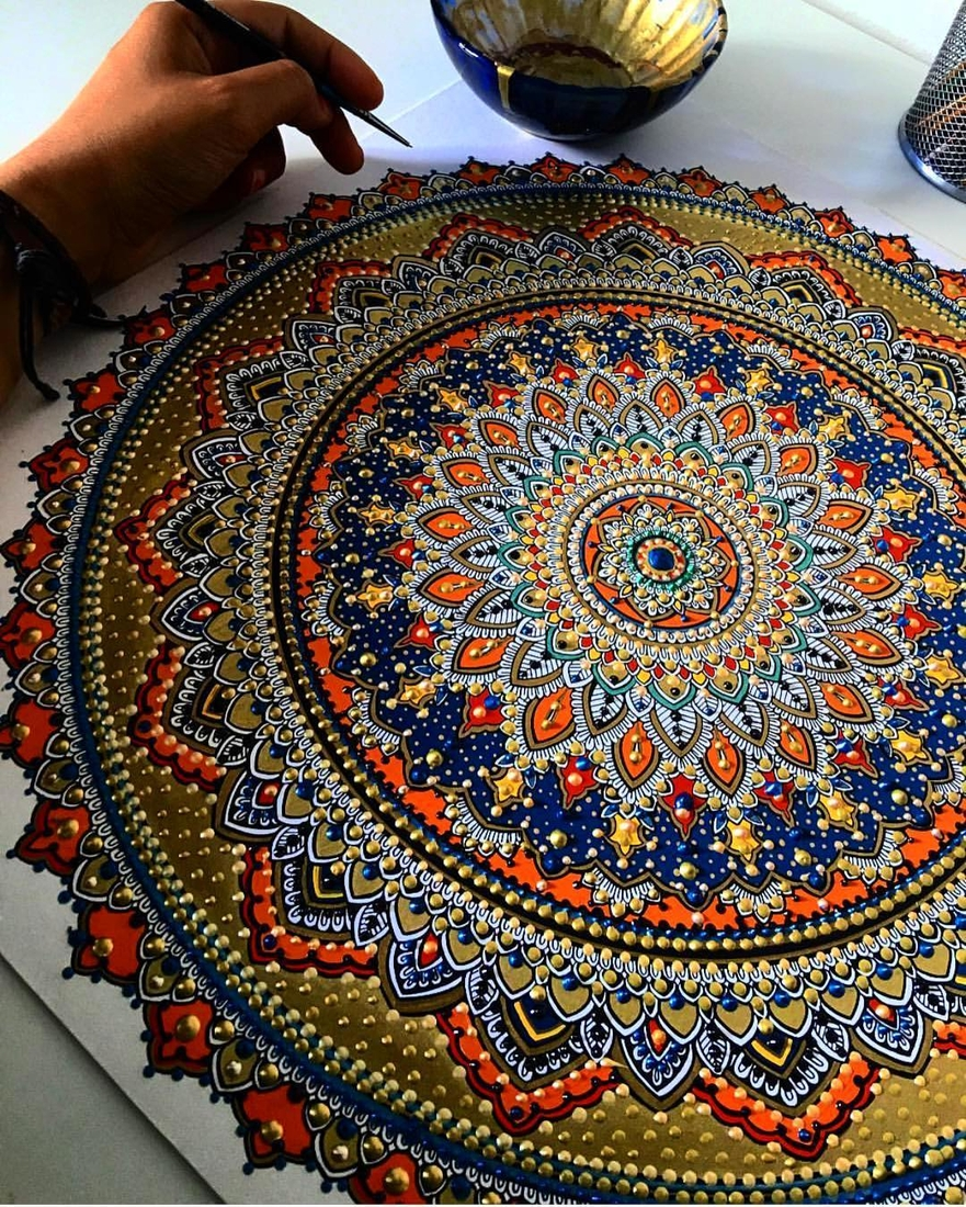 02-Asmahan-Mosleh-Mandala-Drawn-and-then-Painted-with-Color-Themes-www-designstack-co