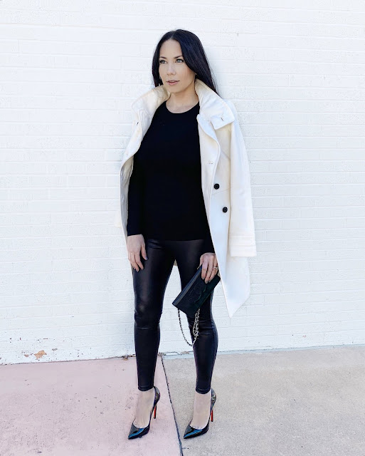 Chic White Coat with Black Buttons, faux leather leggings, and patent pumps, perfect date night outfit for fall or winter www.MalenaHaas.com