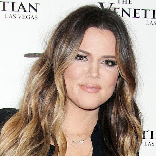 khloe kardashian gold sideways cross necklace