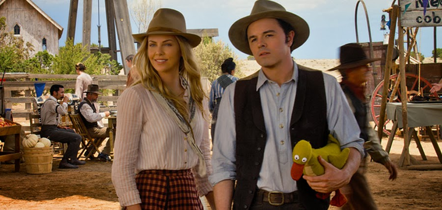 Charlize Theron şi Seth MacFarlane în comedia A Million Ways To Die In The West