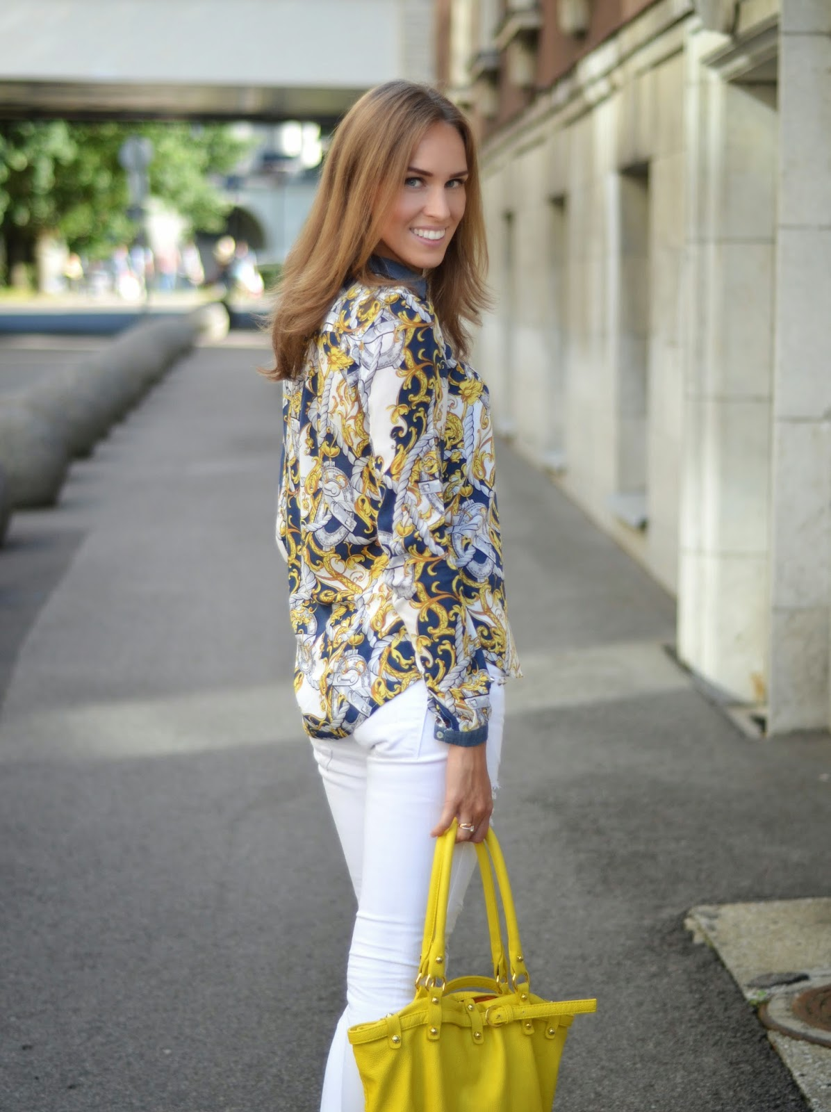 blue yellow print top white pants outfit