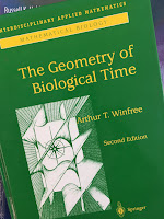 The Geometry of Biological Time, by Art Winfree, superimposed on Intermediate Physics for Medicine and Biology.