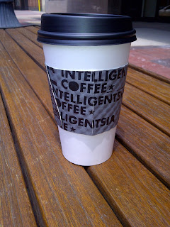 Paper to go cup with Intelligentsia Coffee sleeve