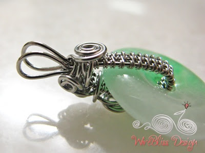 side view of the wire wrapped jade donut pendant
