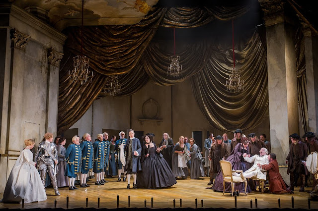 Der Rosenkavalier - Opera North - Fflur Wyn as Sophie, Helen Sherman as Octavian, William Dazeley as Faninal, Helen Évora as Annina, Victoria Sharp as Marianne, Henry Waddington as Baron Ochs and Mark Burghagen as Leopold, with the Chorus of Opera North. Photo Credit: Robert Workman