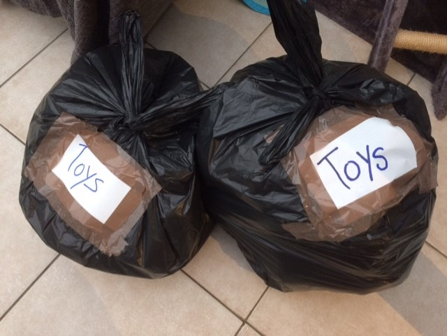 Large full bin liners, tired up and labelled TOYS