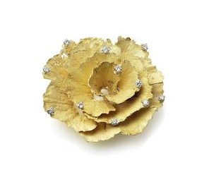 Grima's created this unusual gold and diamond brooch by making a cast from pencil shavings