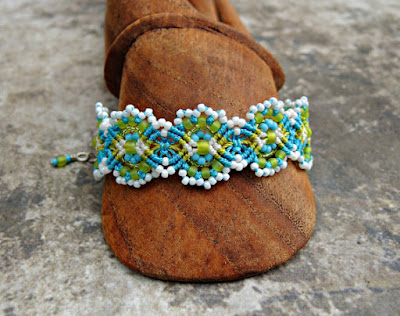 Micro macrame bracelet in Caribbean colors by Sherri Stokey.
