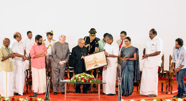 Chief Minister  Pinarayi Vijayan presenting a memento to President Pranab Mukherjee during the latter's visit to Kochi Biennale for inaugurating a seminar.Kerala Governor Chief Justice (Retd) Shri  P Sathasivam ,Prof K V Thomas MP,Minister for Tourism Shri Kadakampally Surendran, Kochi Corporation Mayor Smt Soumini Jain, Shri K J Maxi MLA,Kochi Biennale founders Bose Krishnamachari and Riyas Komu were among the dignitaries.