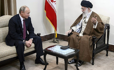 President of Russia Vladimir Putin with spiritual leader of the Islamic Republic of Iran Ayatollah Ali Khamenei.