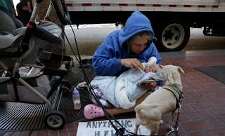Homeless mom panhandles on Market Street with newborn baby