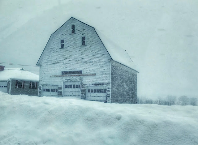 big barn located in Lincoln, Maine, surrounded by piles of snow