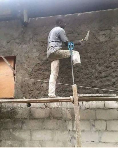 Photo of One Legged Man Plastering A High Wall
