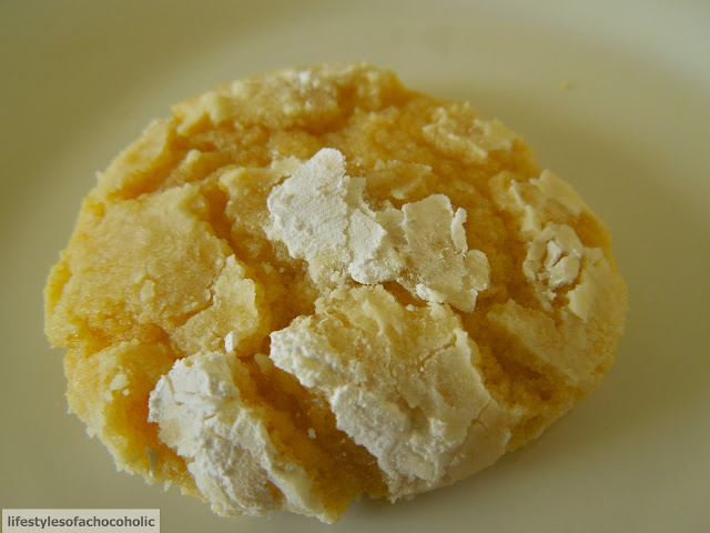 up close of lemon crinkle cookies on a white plate