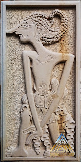 Relief batu alam paras putih/paras jogja motif wayang wisanggeni.