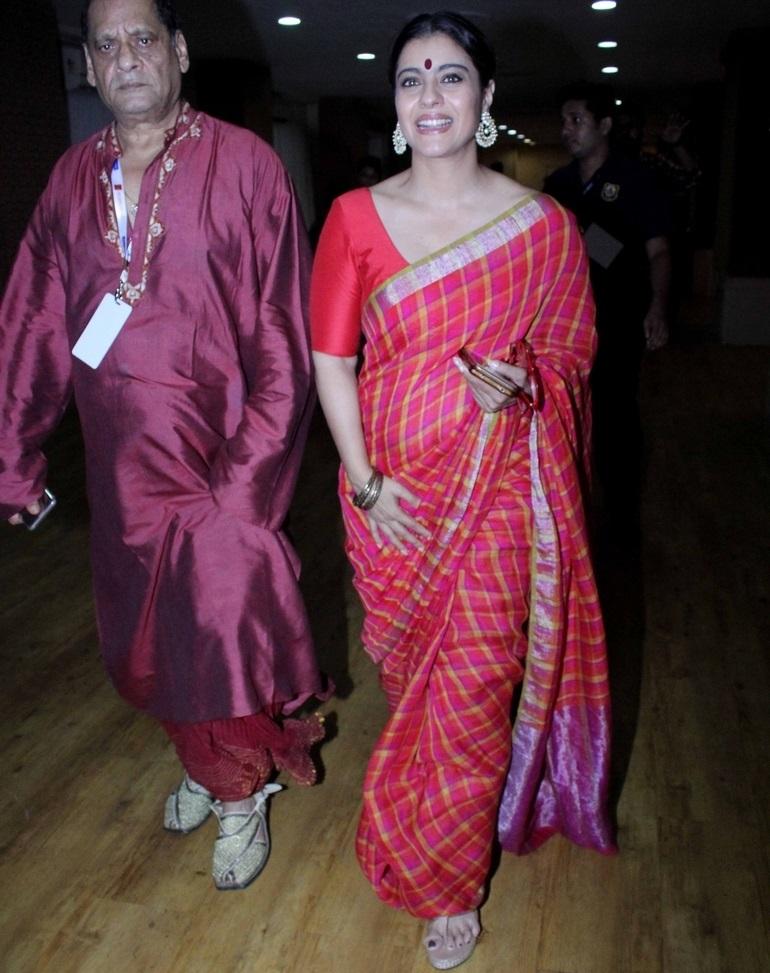 Bollywood Actress Kajol Stills In Traditional Red Saree At Durga Puja Celebrations