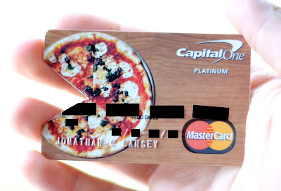 Pizza credit card with a bite