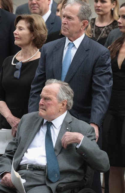 Former president George H.W. Bush with his son former president George W. Bush and former first lady Laura Bush