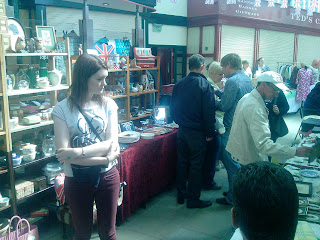 Buyers look over the wares on a vintage stall at Stockport Vintage Village