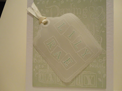 New baby card for Lily Rae, green resist background with parchment tag