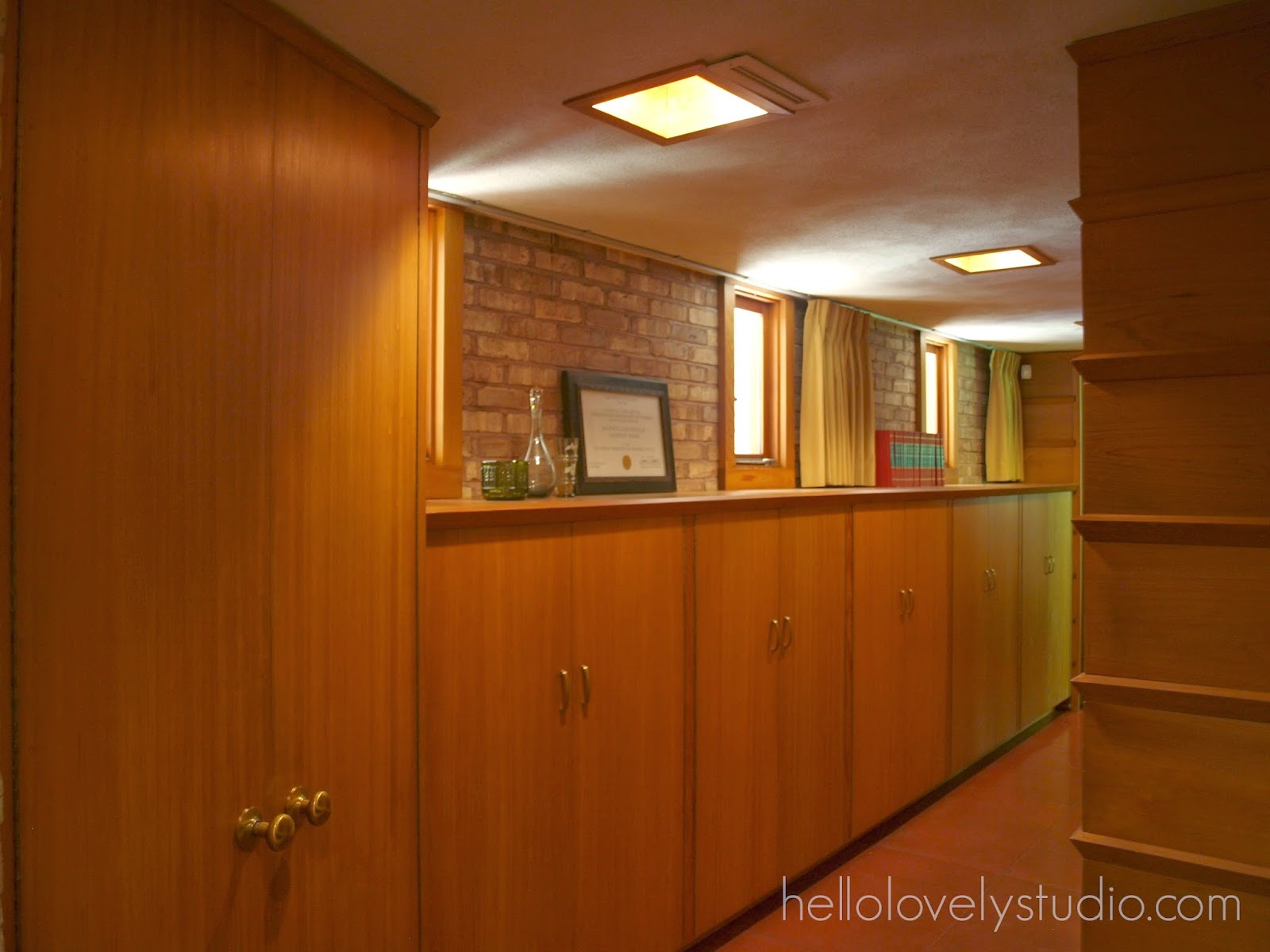 Built-in storage and brick wall. Frank Lloyd Wright Laurent House designed for owner Kenneth Laurent on Spring Brook Road in Rockford/ Designed to be wheelchair-accessible. #flw #franklloydwrighthouse #midcenturymodernarchitecture