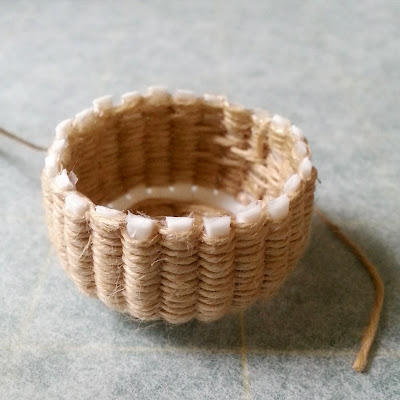 One-twelfth scale miniature almost-completed basket weaving kit.