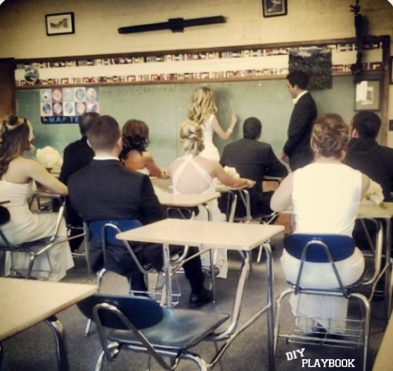 This fun wedding photo in a class room is funny because the bride is a teacher.