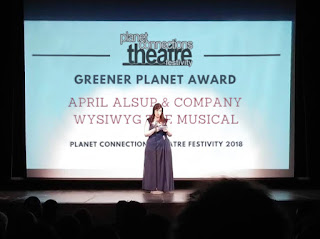 Glory Kadigan announcing 2018 Planet Connections Theatre Festivity Award Winners