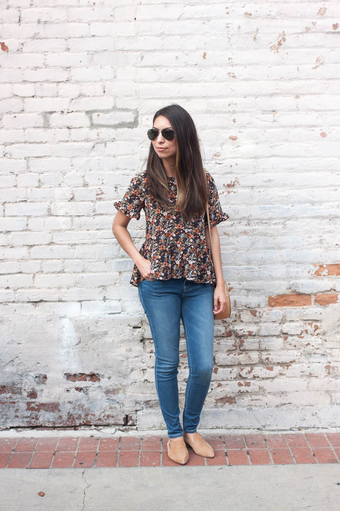 dark floral top and skinny denim pants