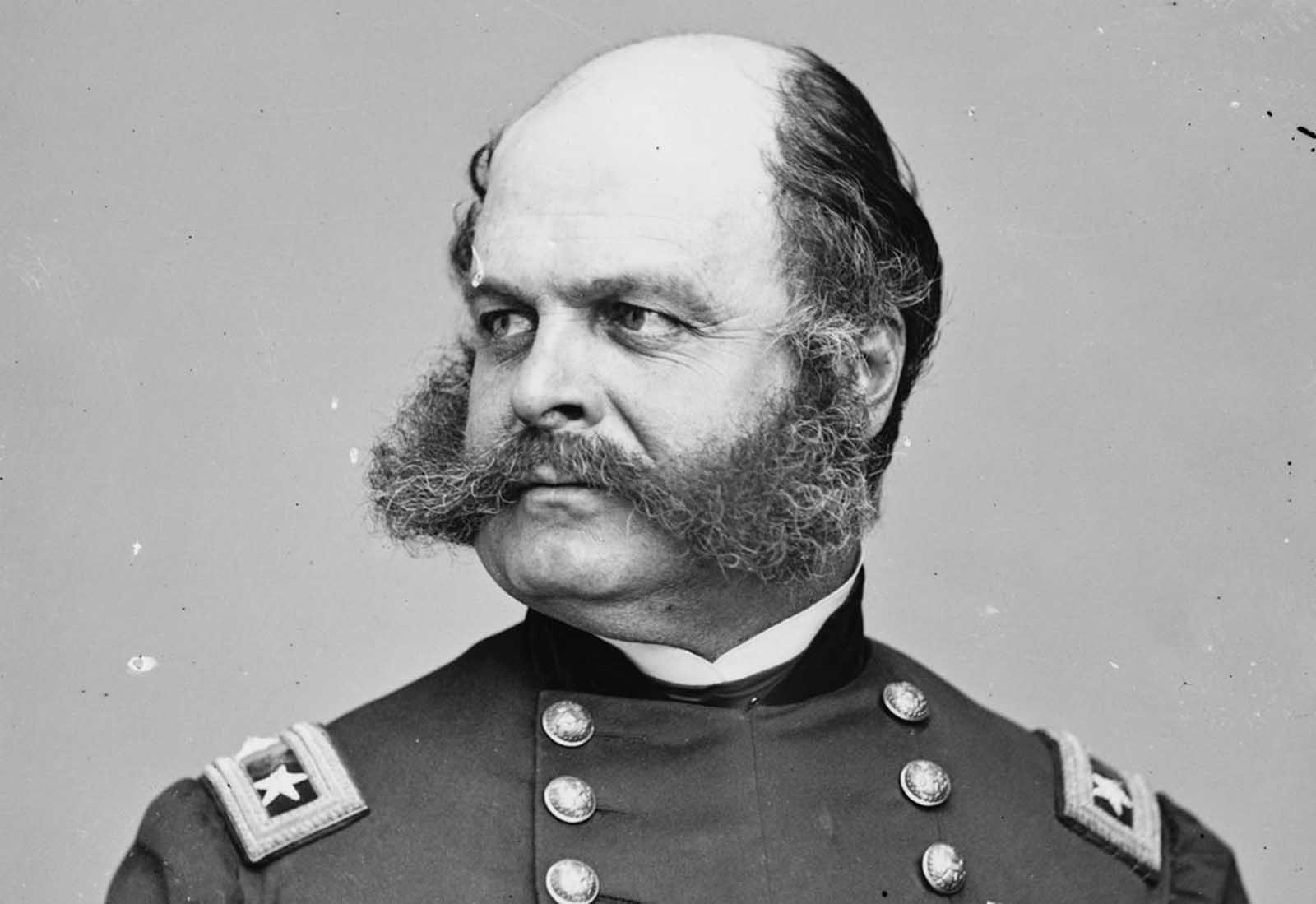 Union Major General Ambrose E. Burnside, conducted campaigns in North Carolina and Tennessee during the war. Afterwards he served as the Governor, and later as U.S. Senator from Rhode Island. His distinctive style of facial hair is now known as sideburns, derived from his last name.
