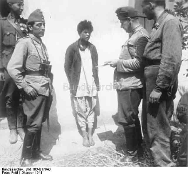Soviet spy being questioned by Hungarian troops,19 October 1941 worldwartwo.filminspector.com