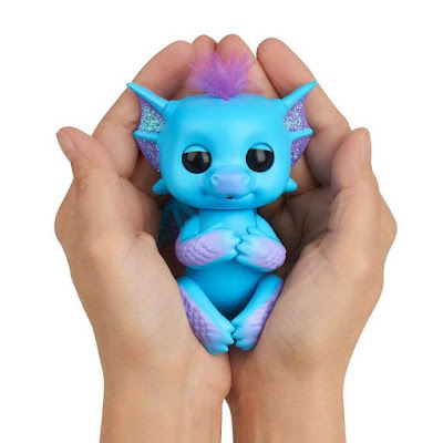 Fingerlings Baby Dragon in person's hands