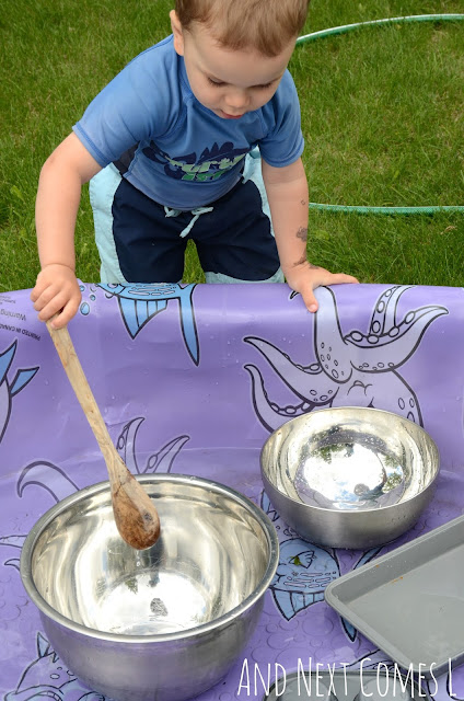 Banging metal bowls as part of an outdoor music science experiment
