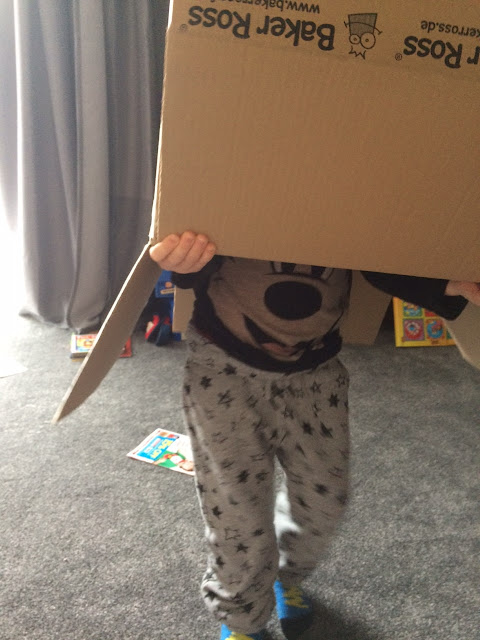 A child with a large box on it's head.