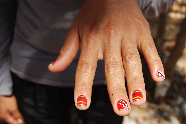 Camila Norma, a FARC guerrilla, shows her painted fingernails at the FARC's Tierra Grata demobilization zone in northern Colombia, in the province of Cesar, near the town of San Jose de Oriente. February 16, 2017. Photo: Anastasia Moloney