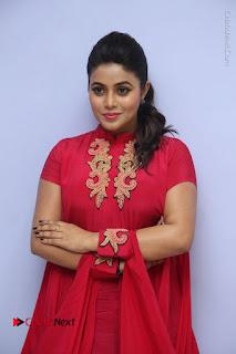Actress Poorna Latest Stills in Red Dress at Rakshasi First Look Launch  0026.JPG