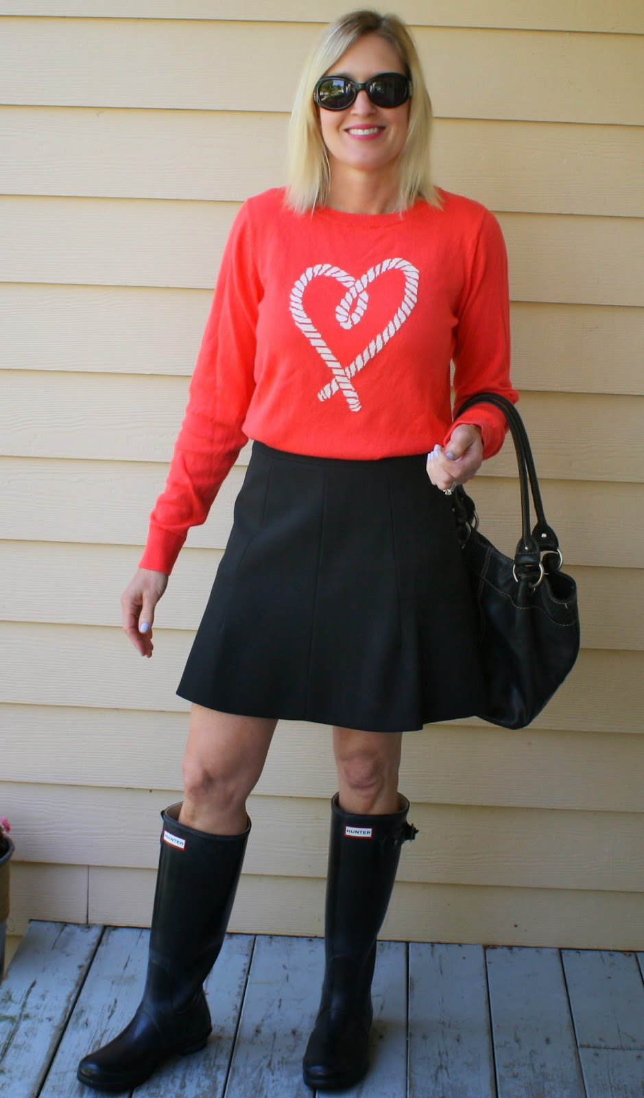 fd48e2a53b2 This look is totally me. I don t have red Hunters or a striped skirt but I  did have the exact sweater in the coral color. I swapped out the stripes  and the ...