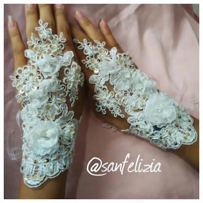 Sarung tangan pendek untuk pengantin. Dengan detail bunga timbul dan full payet. Menerima pesanan bikin jahit sarung tangan pengantin. Selain membuat, kami juga menjual sarung tangan pengantin ready stock