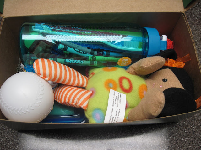 Toys and school supplies added to an OCC shoebox.