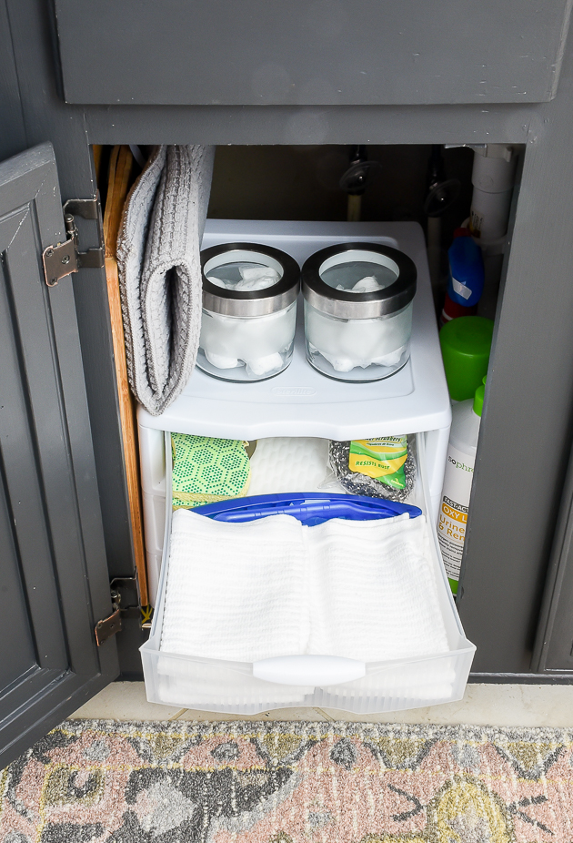 Using storage drawers to organize under the kitchen sink