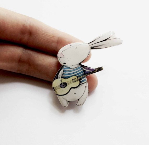 Dinabijushop's polymer clay and resin pin rabbit with guitar